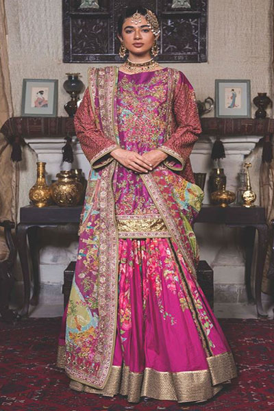 With Embroidery On Sleeves And Neck Line A Flaring Shocking Pinklehenga Fl Digital Prints It The Tta Is Of Light Pink Color Net