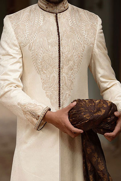This Sherwani Has White Thread Work On Top Of Kurta And Detailed Fine Brown Colored Embroidery Collar The Sleeves Have Piping