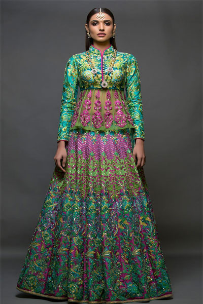 2655931b3a A unique combination of sea-green and magenta, the lehenga has been heavily  embroidered with thread work while the peplum styled top has been  beautifully ...