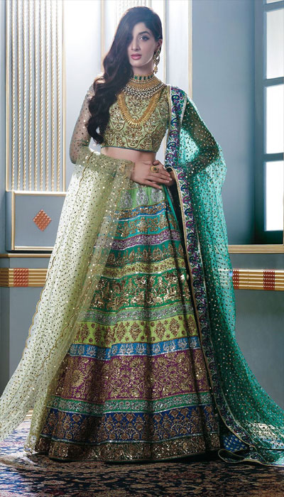 6b895c32c31 The next most talked about bridal dress from Nomi Ansari s latest collection  is this pure raw silk skirt lehnga choli that comes in stunning shades of  green ...