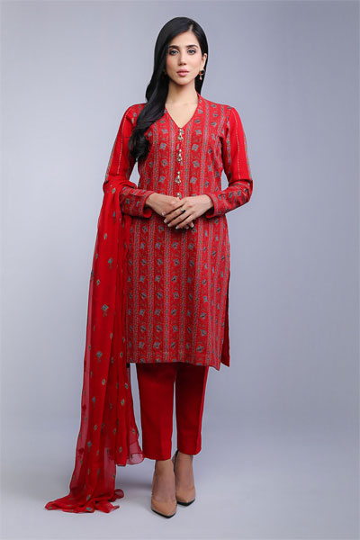 2da0083a06 The red cotton karandi dress comes with a shirt covered in beautiful thread  work, matched with an embroidered chiffon duppata and red trousers.