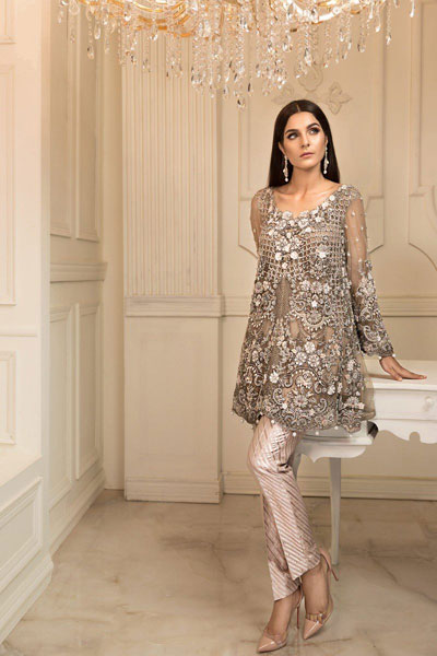 8dff379582 This dress is quite unique from the traditional desi bridal dresses and has  a western touch in it. Its shirt gives dazzling look of a skirt and has  full ...