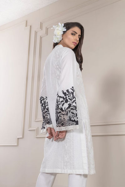 a2f9e695e6 Achieve serenity with this white embroidered lawn dress that comes with  black embroidered sleeves and a full heavy front because even in this  scorching heat ...